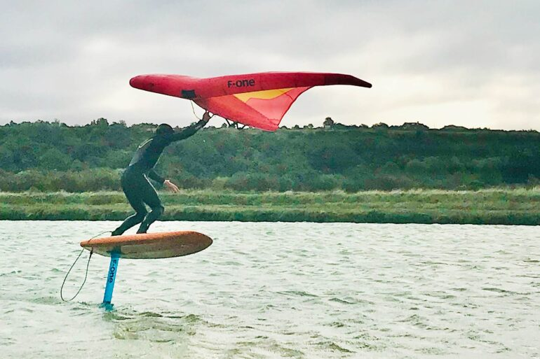 Wing foiling on a river in the UK
