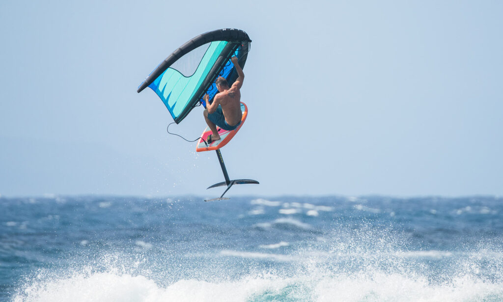Michi Schweiger jumping on a Naish wingsurfer and Hover 75 litre