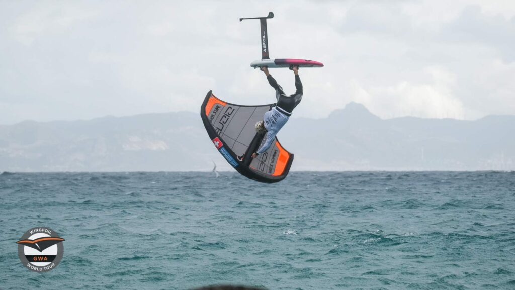 Wing foiling freestyler Balz Muller competing at the Tarifa Wing Pro